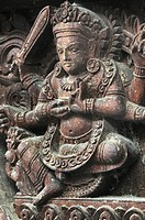 Wooden carving of the God at Vishnu temple, Hanuman Dhoka complex, world heritage monument zone, Durbar Square, Kathmandu, Nepal.