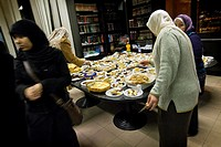Women prepare the sweets  Commemoration of the Prophet Muhammad´s migration memories  Islamic New Year festival  Islamic cultural centre of Segrate, M...