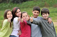 Group of children, thumbs up. Spain.