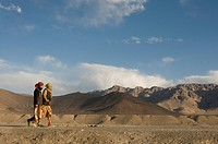 Two women in the mountainous landscape around Murgab, Pamir Mountains, Tajikistan, Central Asia