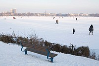 Walkers on the frozen outer Alster lake in the evening, Hamburg, Germany, Europe