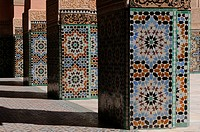 Ornate columns with mosaics, Ali ben Youssef Medersa building, Marrakech, Morocco, Africa