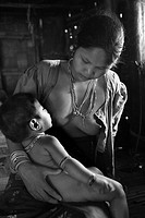 A Mourng tribal woman breast feeds her child Murongs are one of the famous tribes of aborigines of Arakan Two Murong kings ruled Arakan in the tenth C...