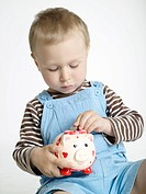 boy with a piggy bank.
