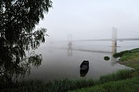 France, Indre-et-Loire, Loire Valley on the UNESCO World heritage list, fog over the Loire river at the bridge of Langeais