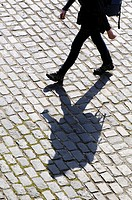 Shadow of person walking