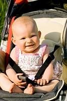 baby girl sitting in a pram