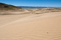 Sand dunes in front of Yarlung Tsangpo and Brahmaputra rivers and the Himalayan main ridge with the Annapurna massif, Western Tibet, Ngari Province, T...
