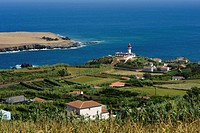 Ilheu do Topo islet and the lighthouse on Sao Jorge island, Azores, Portugal