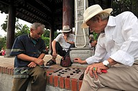 Three men playing Chinese chess, Den Ngoc Son, Temple of the Jade Mound, Hanoi, Vietnam, Southeast Asia