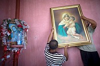 Central American migrants traveling across Mexico to work in the United States hang a picture of the Schöenstatt Virgin on the wall at the Catholic pr...