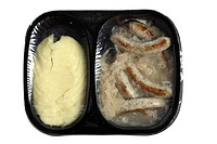 Meal in a plastic container, pre-cooked, portioned for one person, Nuremberg sausages with sauerkraut and mashed potatoes