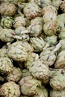 Artichokes for sale on market stalls