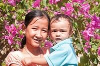 Young girl with a small child in her arms, Phu Quoc, Vietnam, Asia