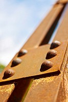 Rural iron truss bridge with rust and rivets