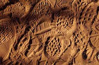 Boot and shoe prints in sand