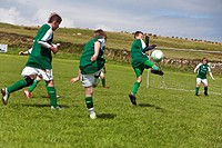 Young boys playing football, County Clare