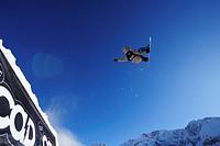 Snowboarder jumping from a kicker, performing a back_flip, funpark Ehrwalder Alm, Tiroler Zugspitzarena, Ehrwald, Tyrol, Austria