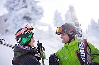 Two male free skiers shaking hands, Mayrhofen, Ziller river valley, Tyrol, Austria