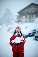Girl 5 years catching snowflakes on tongue, Hotel Chesa Valisa, Hirschegg, Kleinwalsertal, Vorarlberg, Austria