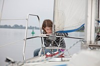 Girl on a sailing boat reading, Brandenburg an der Havel, Brandenburg, Germany