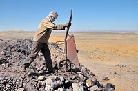 Worker with traditional Litham turban, mining of lead sulphide, border area between Morocco and Algeria, Africa