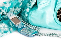 womanish handbag, scarf and mobile phone