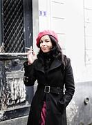 Portrait of woman smoking in street