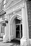 Black and white photo of a elaborate Masonic Temple entrance with signs