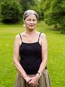 Senior woman standing in park