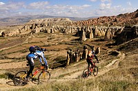 Mountain bikers near Cavusim, Goereme valley, Goereme, Cappadocia, Turkey