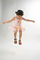 young girl of 4 years dancing and jumping in mid air MR 687D
