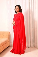 South Asian Indian South Asian Indian young lady wearing red sari and gold chain MR687N