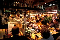 People at a bar at market hall Mercat de la Boqueria, Barcelona, Spain, Europe