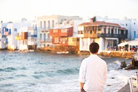 Young man looking at sunset on Mykonos Island, Greece