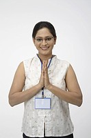 Young girl pose of welcoming or Namaste posture with both hand palms joining together MR 703C