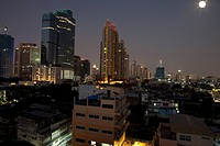 Full moon over Sathorn business area, Bangkok, Thailand