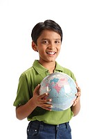 Ten year old boy holding globe in his both hand MR703V