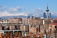 Views from Madrid, with the Four Towers, telecoms tower 'Piruli', Kio Towers in the background and the Sierra of Madrid snowed