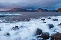 Waves crash over rocky shore at Elgol, Isle of Skye, Scotland