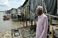 Old black man outside his home in the Bajamar slum, Buenaventura, Valle del Cauca, Colombia, South America