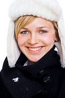 Woman in warm clothing, smiling