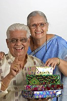 South Asian Indian happy old couple holding gifts MR670L670M