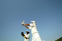 Indian right handed batsman in action playing lofted cut shot in cricket match MR705L