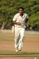 Indian fast bowler in action of bowling in cricket match MR705H