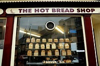 Loaves of bread and buns on display in a baker´s shop window, Aberystwyth, Wales