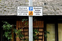 Bilingual sign dictating parking for disabled people only outside a day centre for the elderly, Aberystwyth, Wales
