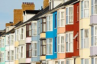 Brightly coloured seafront housing in Aberystwyth, Wales