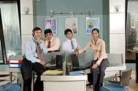South Asian Indian businessmen and woman sitting working on laptop in office MR 670E , 670F ,670G , 670H