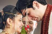 Bride and bridegroom performing ritual in Indian Hindu wedding ceremony MR719R,716S